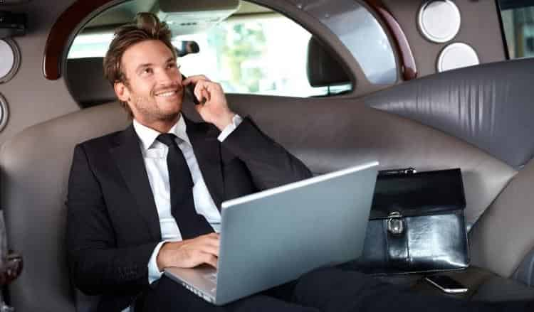 Man taking call in back of Luxury limousine, limo