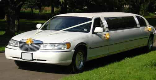Wedding White Stretch ten passenger Limo, bride and groom